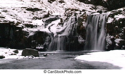 Waterfall in Wintertime - Waterfall in Iceland in wintertime