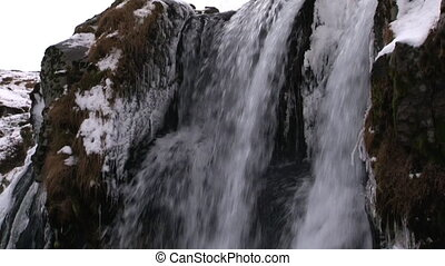 Waterfall in Wintertime - Waterfall in Iceland in...