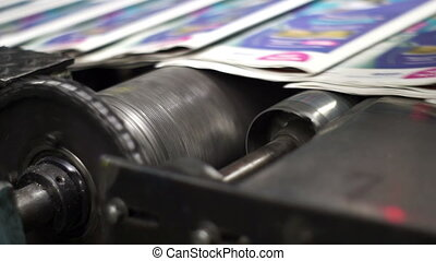 Offset Press Finished Newspapers - Close up handheld shot of...