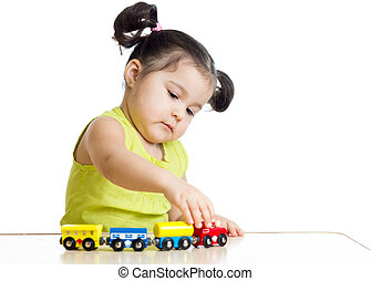 Kid girl playing with train toy isolated on white
