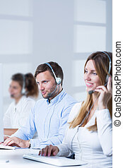 Workers of telesales center - Picture of teleoperators team...