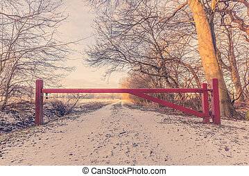 Wooden barrier on a nature path at wintertime