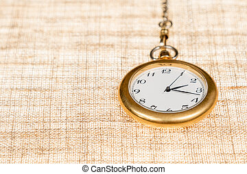 Old pocket watch close up - Old gold pocket watch on a chain...