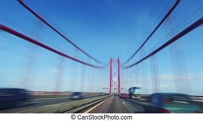 Speedy Driving on a 25 de Abril Bridge in Lisbon, sunny...
