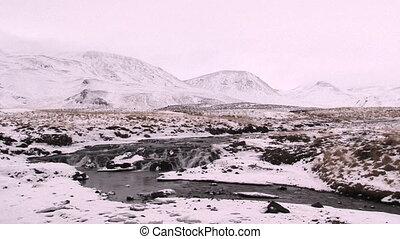 Waterfall in Icelandic winter landscape - Waterfall in...