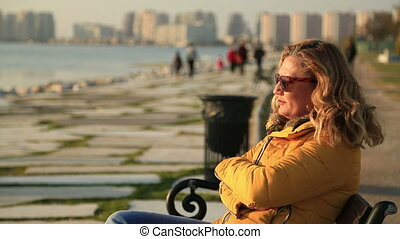 Woman sitting at the seaside - Portrait of a woman sitting...