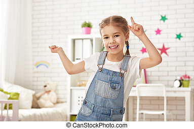 girl plays at home - funny child girl plays at home. girl...