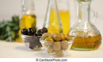 Olives and Pouring Olive Oil. Extra virgin olive oil pouring...
