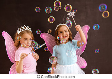 Young fairy queens - Two little fairy with pink wings and...