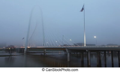 Traffic on the Margaret Hunt Bridge on foggy morning in Dallas