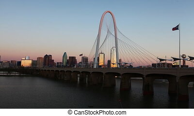 Timelapse day to night on the Margaret Hunt Bridge into...