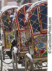 Wheeled rickshaws waiting for customers in Kathmandu