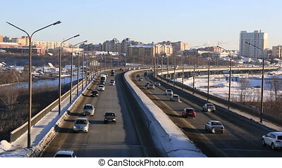Car traffic on bridge Winter city Omsk Timelapse - Car...
