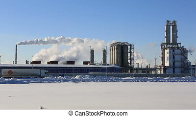 Factory, smoke and blue sky in winter morning
