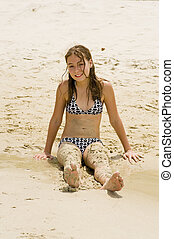 at the beach covered with sand - blond teenager at the beach...