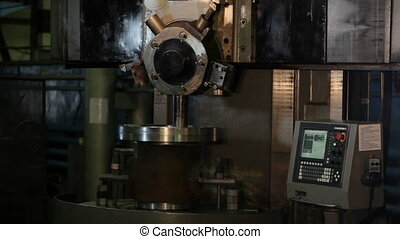 Industrial lathe works in factory