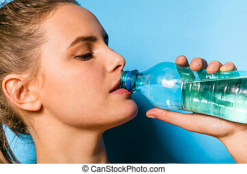 young athletic woman with a bottle of water