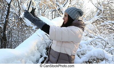 Beautiful happy woman doing self on the tablet Snow covered...