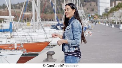 Attractive casual young woman standing laughing - Attractive...