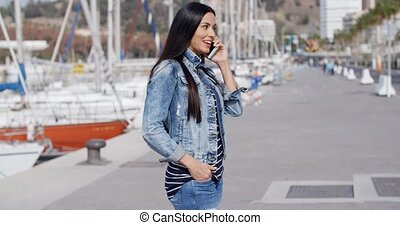Trendy relaxed young woman talking on a mobile - Trendy...
