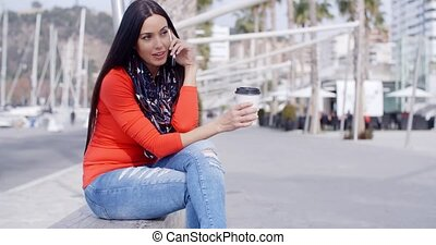 Relaxed confident young woman on a mobile