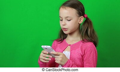 Emotional little girl talking on Skype at phone. - Emotional...