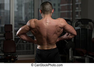 Man Showing His Well Trained Back - Portrait Of A Physically...