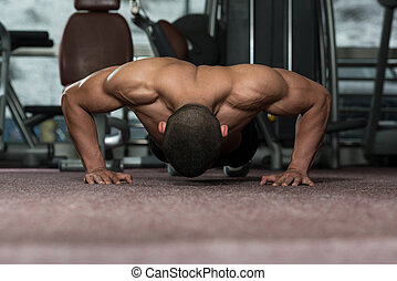 Young Man Doing Press Ups In Gym - Young Adult Athlete Doing...