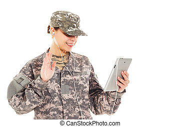 Girl-soldier in the military uniform - Young smiling...