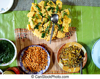 Indian dish of Dhokla, namkeen and chutney - Indian dish of...