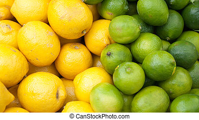 lemons and limes - lemons and limes stacked up for sale on a...