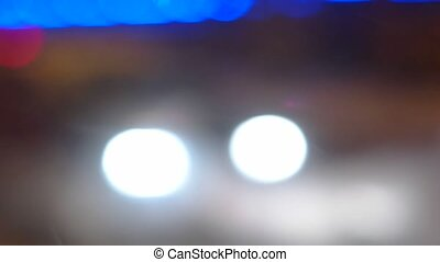 Defocused blurred abstract lights from night traffic with snow in the foreground