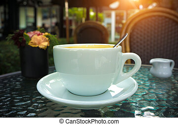 A cup of americano Coffee in coffee shop - vintage and...