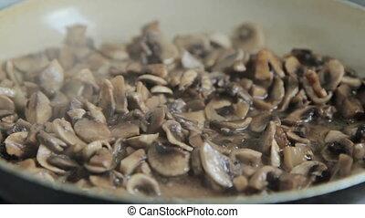 Grinded mushrooms roasting in pan. - Grinded mushrooms...