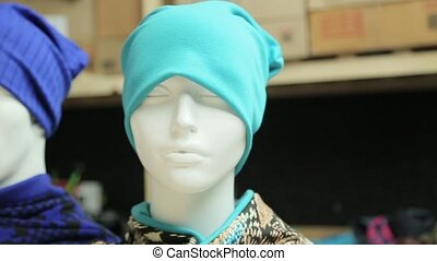 Mannequins with hats on head
