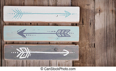 Three hand painted arrows