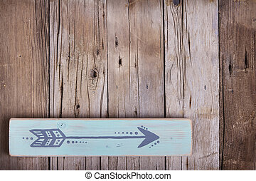 One hand painted arrow on a wooden plank
