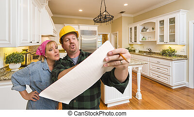 Contractor Discussing Plans with Woman Inside Custom Kitchen Interior