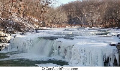 Frozen Lower Cataract Falls Loop - Water flows through a...