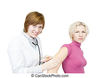 Doctor giving a girl an intramuscular injection in arm over...