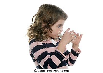 brunette little girl drinking glass of milk isolated on...