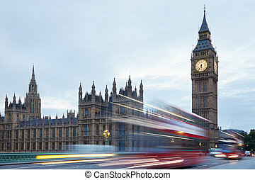 Big Ben and Palace of Westminster in the early morning, red...