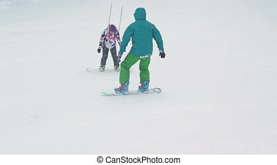 Girl balancing on snowboard. learning.