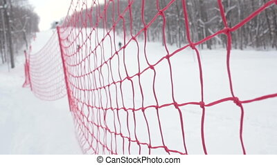 The modern red rope grid piste for alpine skiing. With...