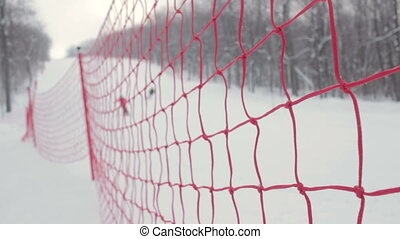 The modern red rope grid piste for alpine skiing With skiers...