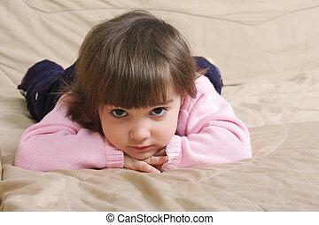 Girl laying on sofa