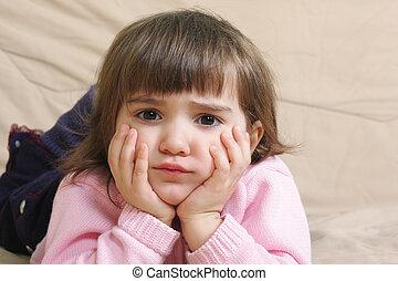 Sad girl on sofa