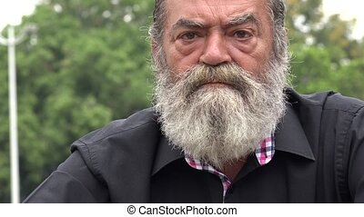 Old Bearded Man Talking
