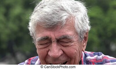 Excited And Laughing Older Man