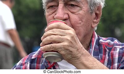 Senior Drinking Refreshing Beer Or Soda